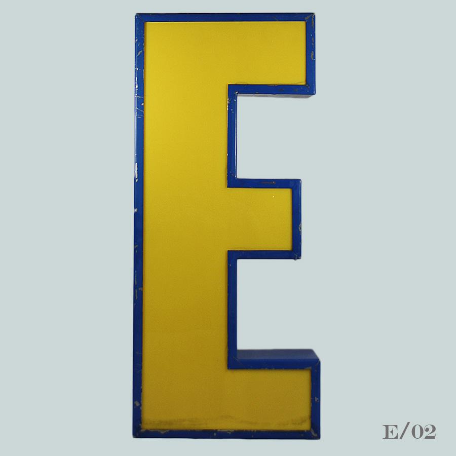 vintage blockbuster illuminated letter E