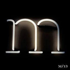 neon M letter light seletti
