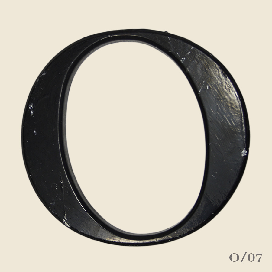 vintage black resin letter o