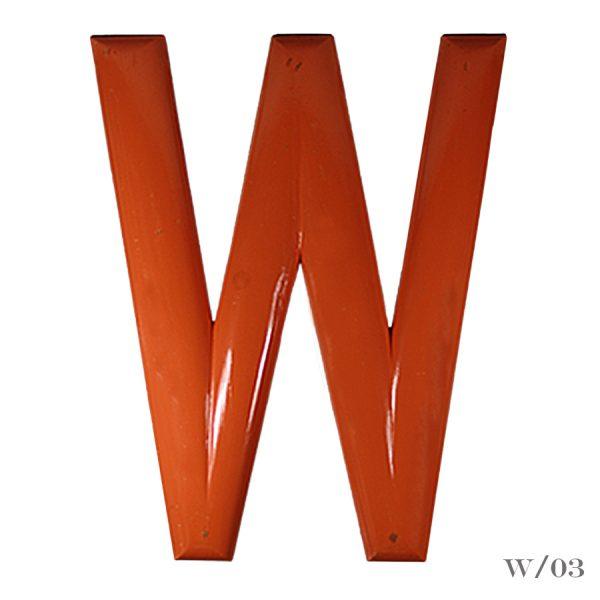 large vintage fairground letter W painted orange
