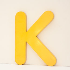 Reclaimed Yellow Resin Letter K