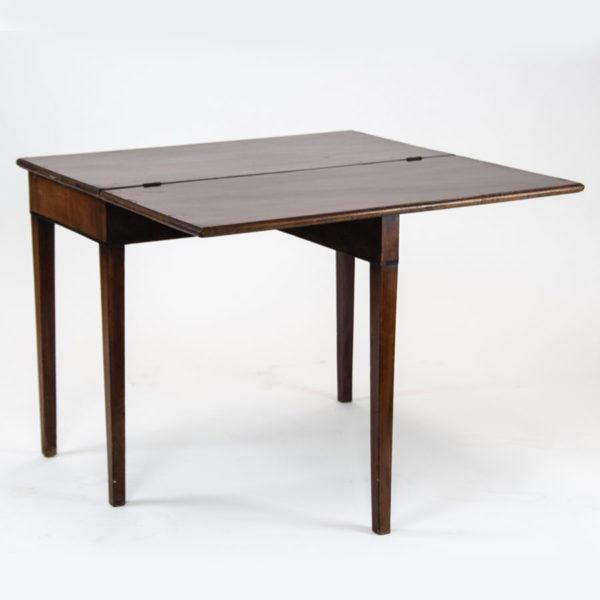 Antique folding tea / card table